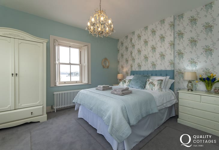Luxury Pembrokeshire holiday cottage - king size master bedroom with garden and Cleddau River views