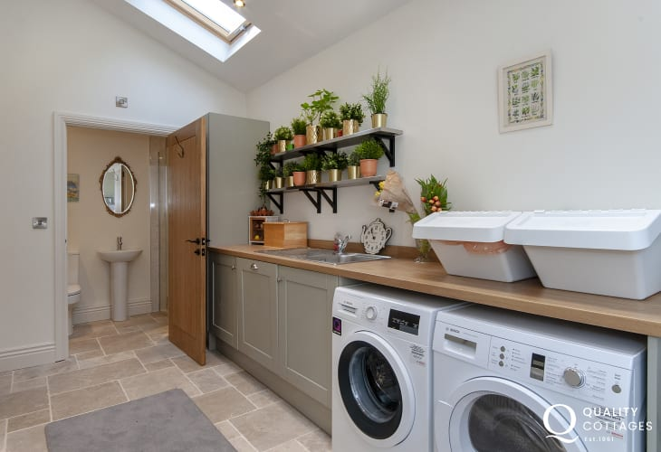 Fully equipped utility room with cloak room and shower
