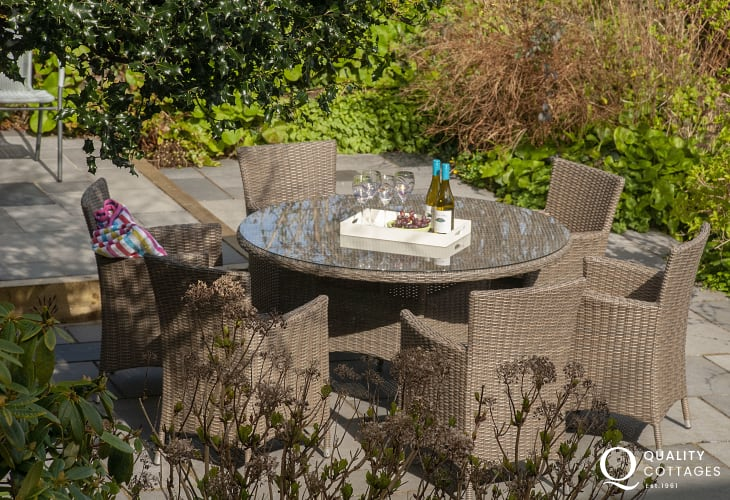 Relax in Rattan garden furniture at Railway Cottage