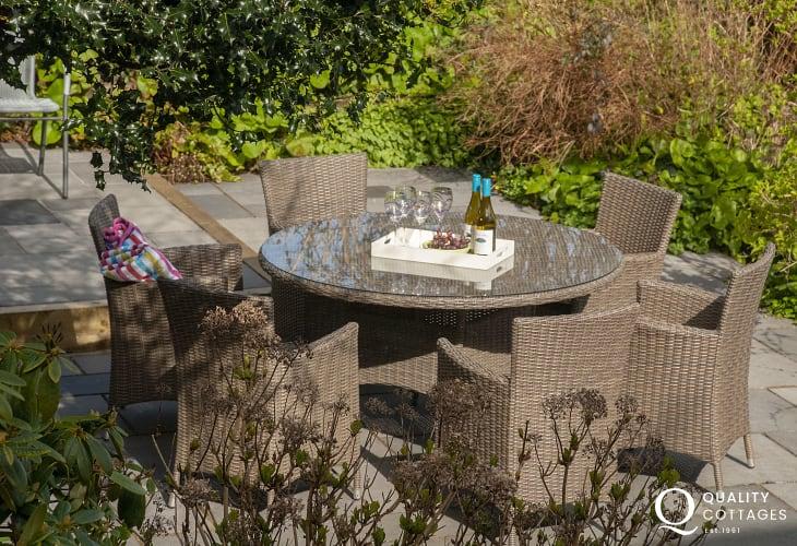 Relax in Rattan garden furniture at Railway Cottage