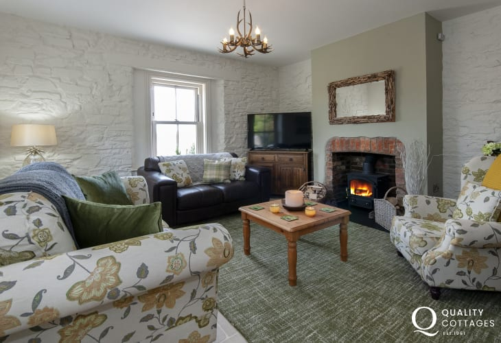 Pembrokeshire holiday cottage with river views - cosy sitting room with 52