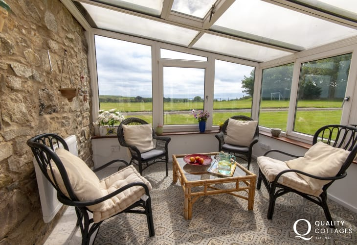 Solva holiday barn - large conservatory with garden views