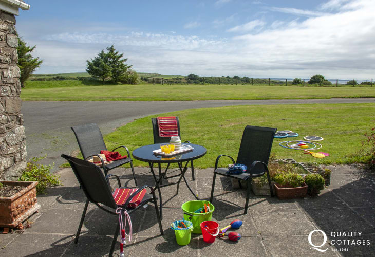 Solva holiday home on the Pembrokeshire coast - patio with garden and coastal views