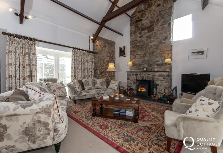 Solva family holiday home - sitting room with wood burner