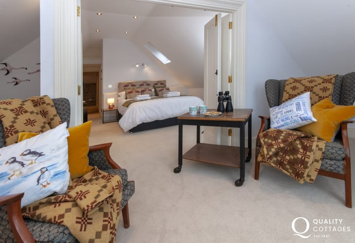 Pembrokeshire pet friendly holiday cottage -  en-suite bedroom reading room area, with coastal views