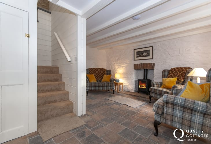 Abercastle pet friendly holiday cottage - cosy sitting room with log burner