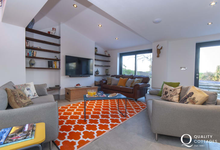 Luxury coastal holiday cottage near St. David's, Pembrokeshire - open plan lounge with TV and comfortable sofas