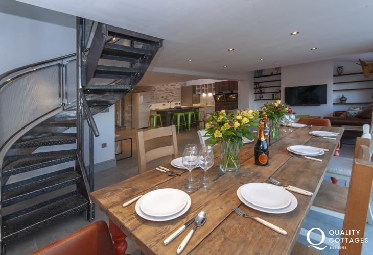 St. David's Peninsula dog friendly holiday cottage - open plan dining room with bespoke spiral staircase.