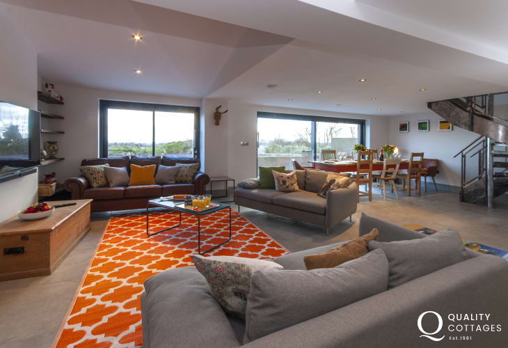 Holiday cottage with sea views, near Porthgain, Pembrokeshire  - modern open plan lounge with spiral staircase and garden