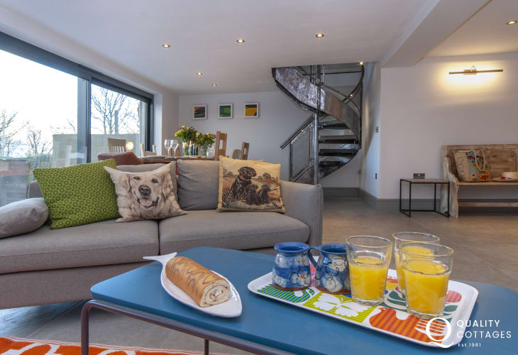 Aberbach, Pembrokeshire, coastal holiday cottage - open plan dining room with locally hand-crafted feature spiral staircase