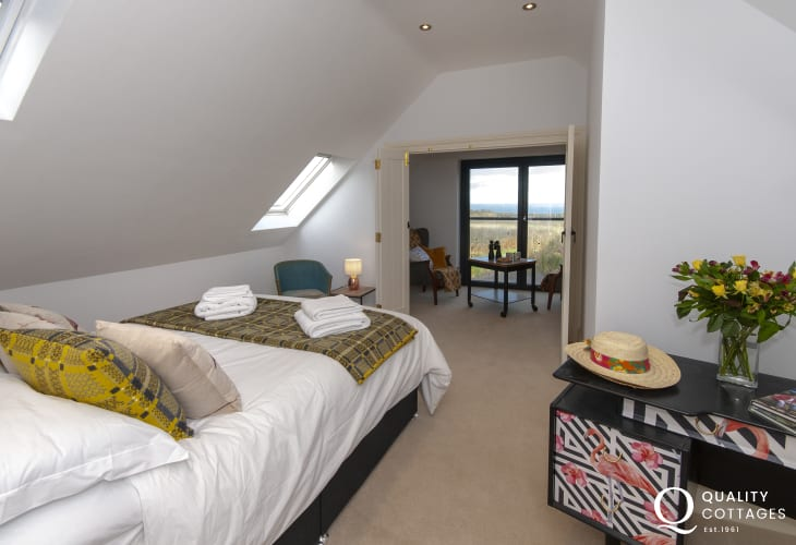 Abercastle luxury holiday cottage - double bedroom with en-suite, sitting area with coastal views and telescope