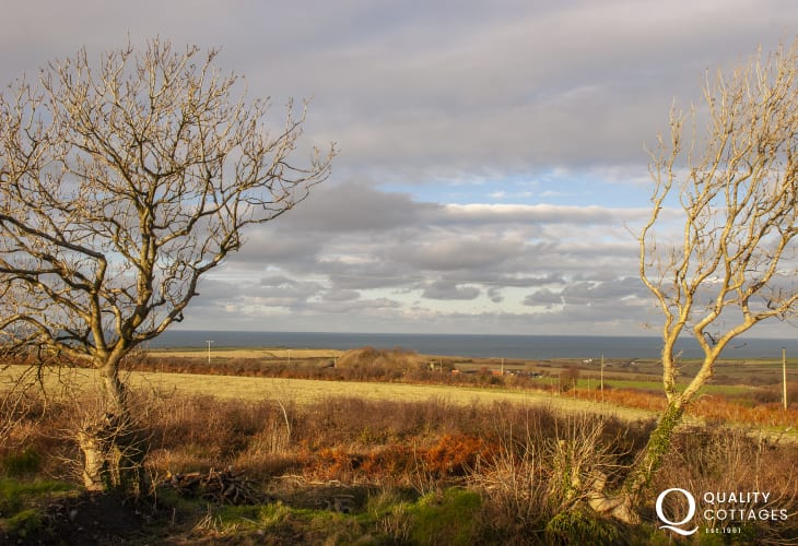 A winter view of the countryside and coast from the reading room at Belle Vue holiday cottage, near Porthgain, Pembrokeshire