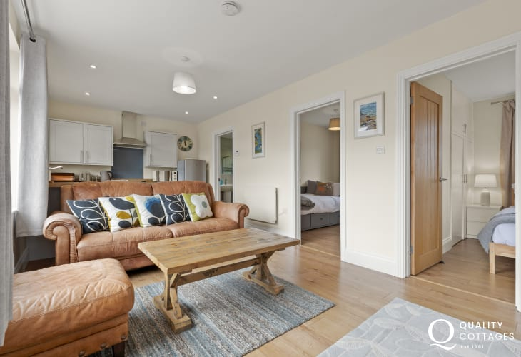 Swansea short distance from holiday cottage - sitting room leather sofa, armchairs, large screen TV