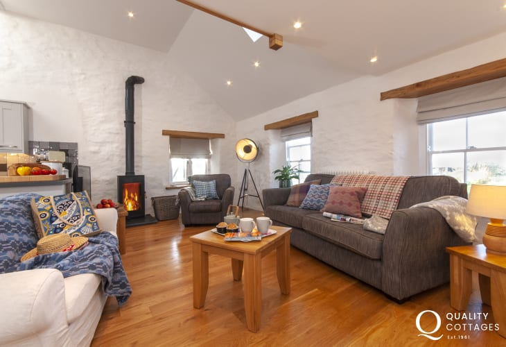 North Pembrokeshire holiday home - open plan living room with log burning stove