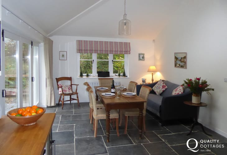 New Quay seaside town cottage holiday - kitchen/dining area garden views