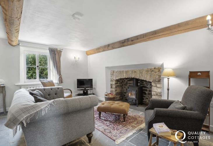 Cardigan Bay character cottage for holidays-sitting room with wood burner