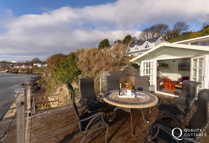 Pembrokeshire waterside cottage - deck with summer house and Haven Waterway views
