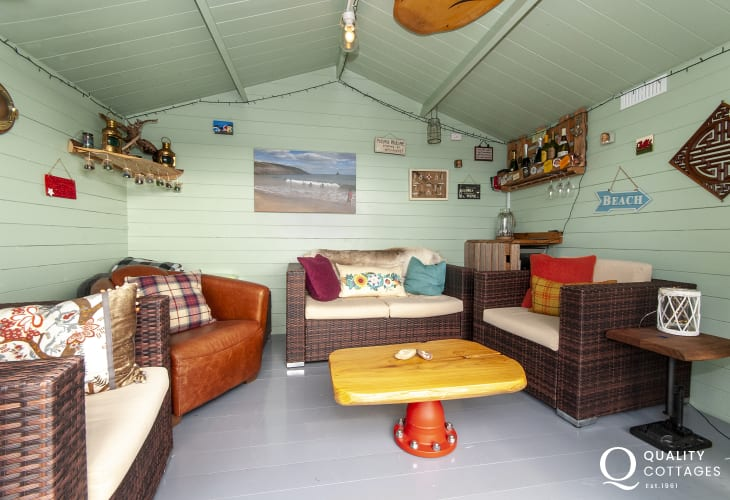 Pembrokeshire holiday cottage - lower deck with summer house and Haven Waterway views