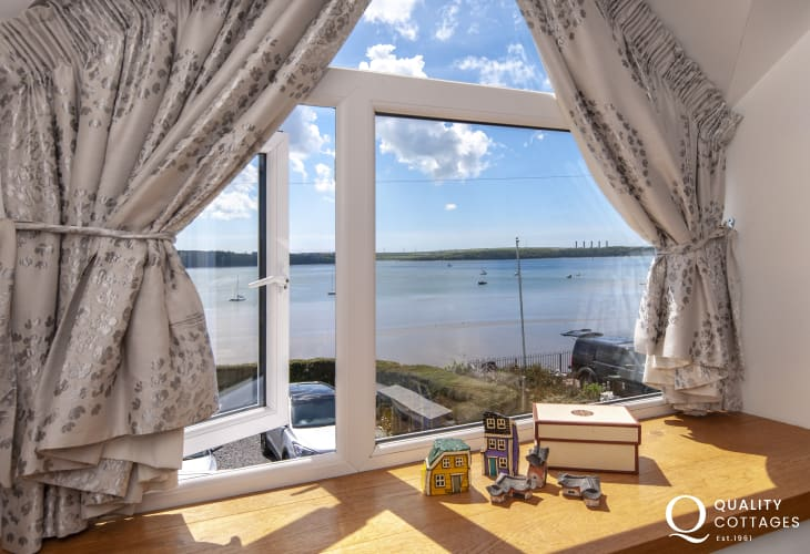 Stunning waterside views from the king size master bedroom