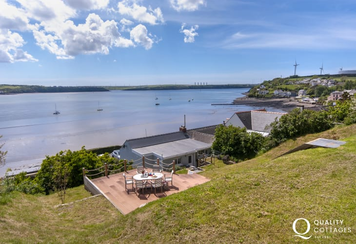 South Pembrokeshire holiday cottage - upper gardens and deck with stunning waterway views