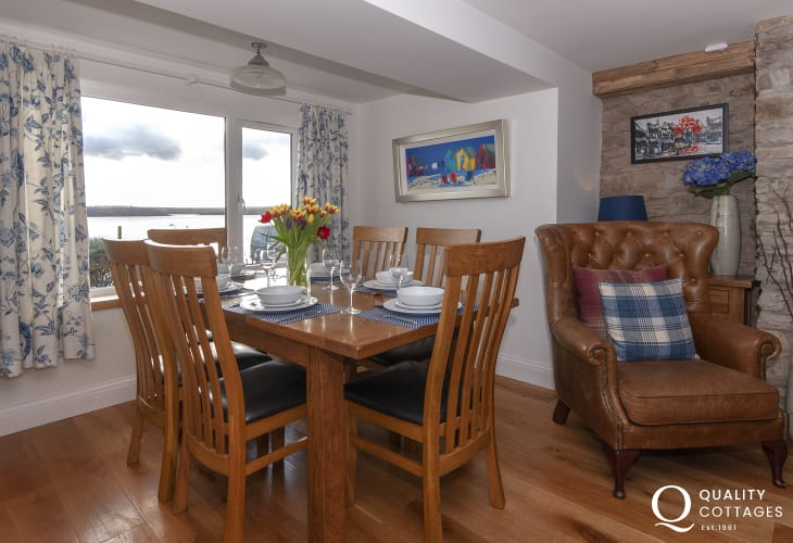Restored Welsh cottage on the Haven Waterway - cosy snug/diner with wood burning stove
