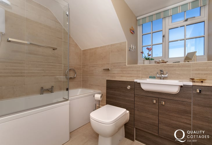 Solva holiday home - family bathroom with shower over bath