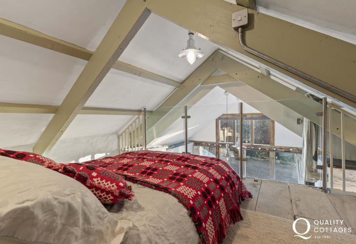Traditional restored Welsh cottage - loft sleeping platform double bed Welsh throws & cushions