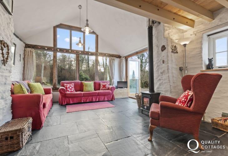 Llandysul cottage holiday  - sitting room with wood burner comfortable sofas