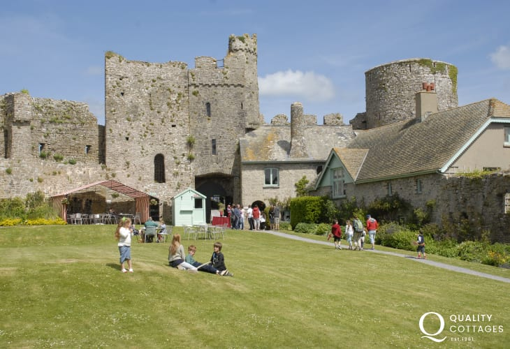 12th century Manorbier Castle has historical displays, life size figures, towers, battlements and a dungeon to explore.