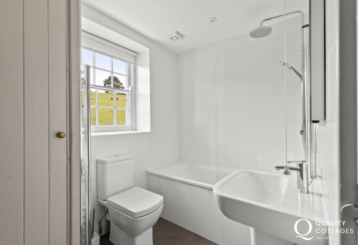 Cottage holiday bathroom with shower in bath