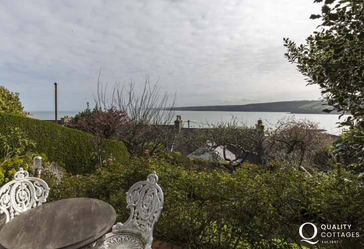 Cardigan Bay for holidays in West Wales - Garden lawned area and patio with stunning sea views across Cardigan Bay