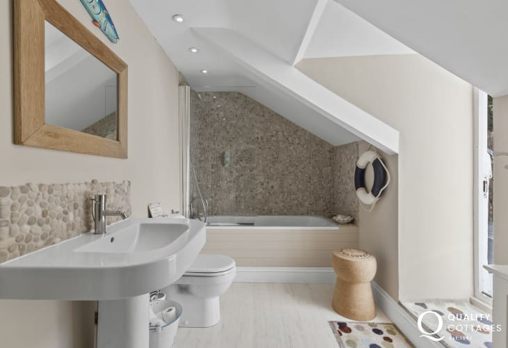 Picturesque village of New Quay - Family Bathroomattractive room with a beach theme, bath with shower over