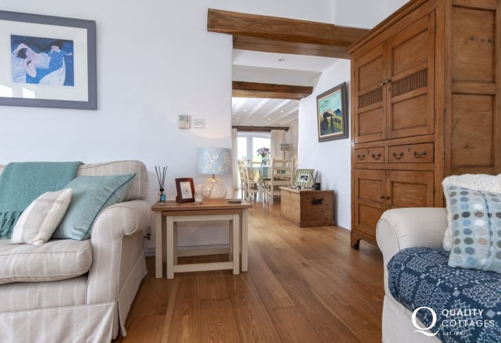Pembrokeshire traditional cosy holiday cottage - living room with antique armoire