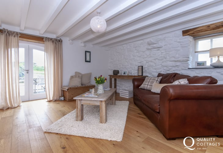 Abereiddy family holiday cottage - snug with glass doors to the patio
