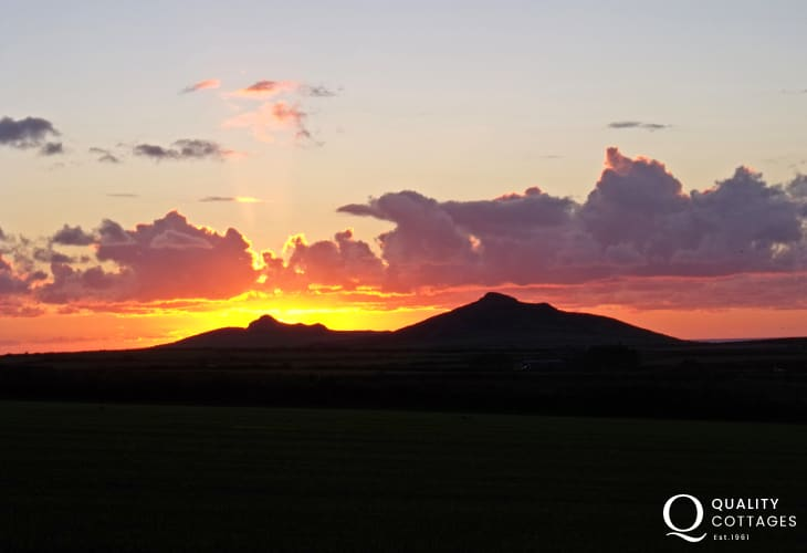 Watch an autumn sunset over Carn Llidi from the patio