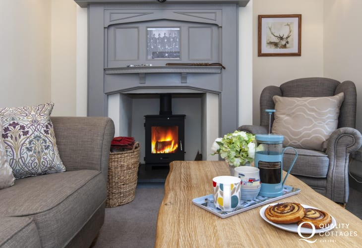 Restored Pembrokeshire Police House for rent - cosy sitting room with log burner