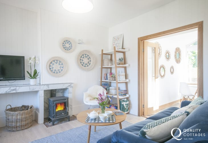 Dale, pet friendly modern holiday bungalow - living room with log burner and wifi
