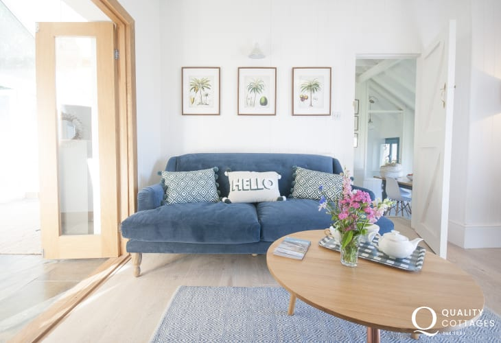 Dale holiday home - comfy living room with Oak doors to rear conservatory