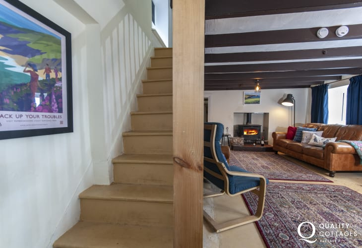 Abercastle pet friendly holiday cottage - living room with wifi and log burner