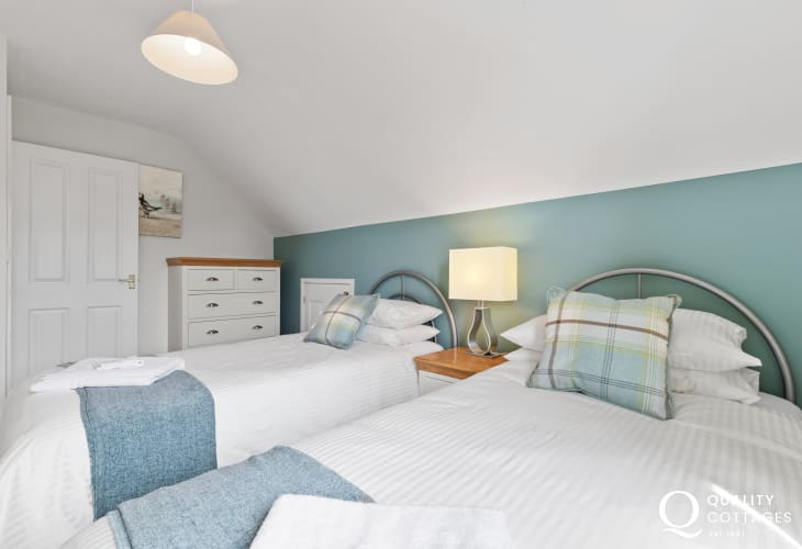 Luxury Pembrokeshire holiday cottage - twin bedroom chest with bedside table
