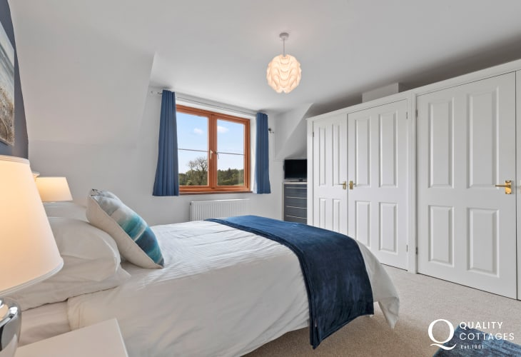 Nearby seaside town Saundersfoot - master bedroom with fitted wardrobes