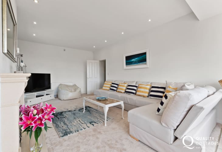 Boat trip to Caldey Island from Tenby holiday cottage - lounge with large corner sofa and large smart TV.