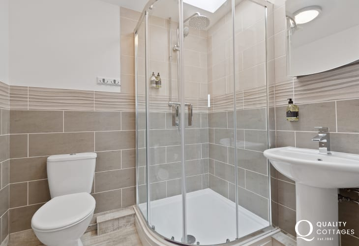 Bathroom with shower cubicle, toilet and washbasin