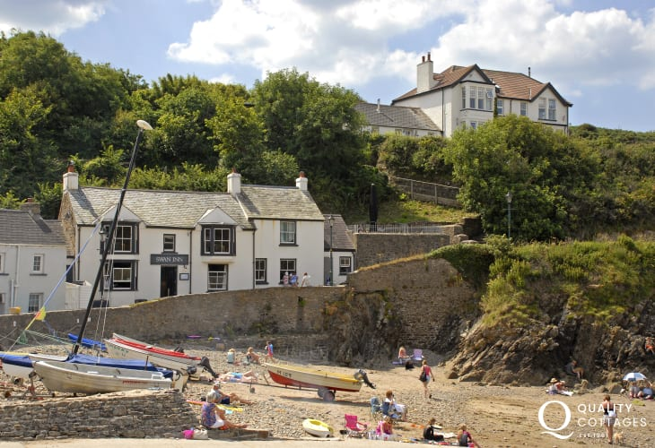 Book a table at The Swan Inn - a very popular pet friendly pub over looking the beach