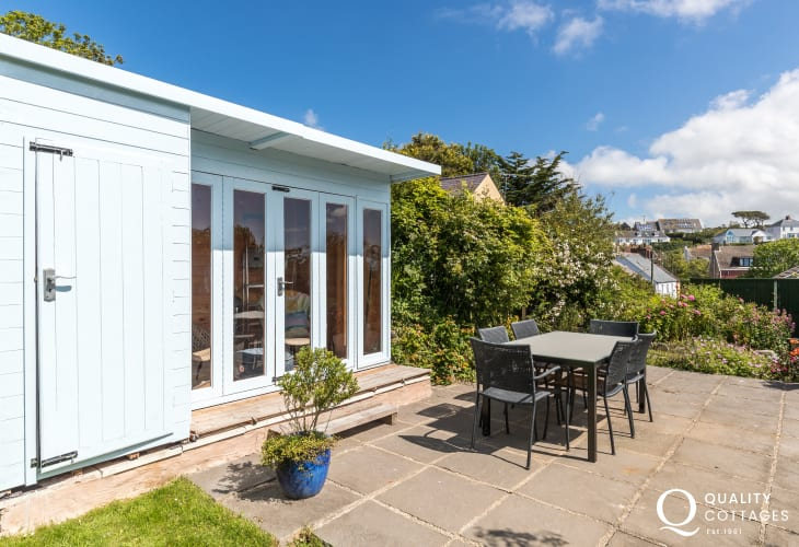 St Davids holiday cottage - patio with summer house