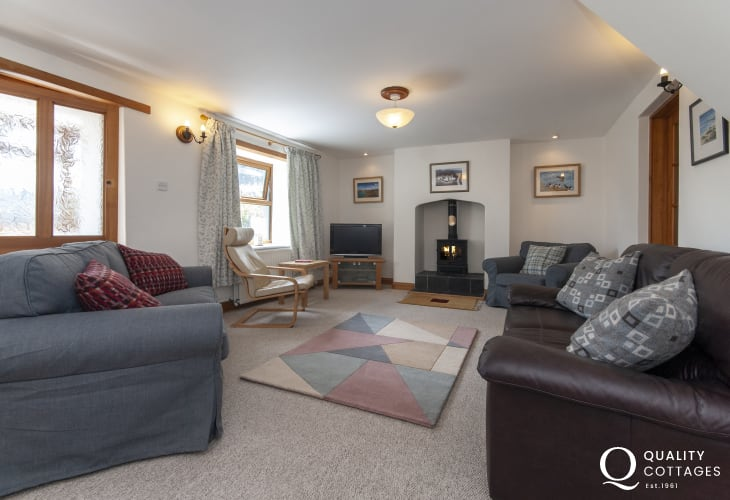 Abermwr holiday cottage open plan sitting/dining room with log burning stove