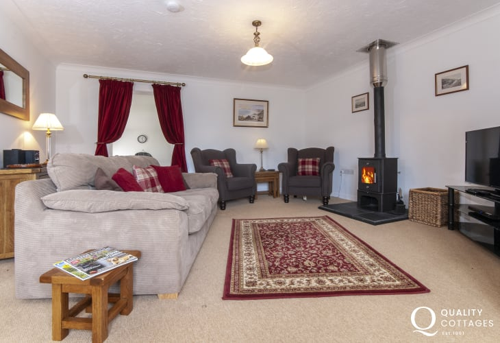 Solva coastal holiday cottage - sitting room with wi-fi and log burning stove