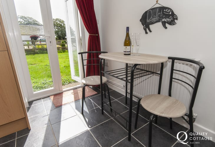 Solva self-catering farm retreat -kitchen bar stools and table