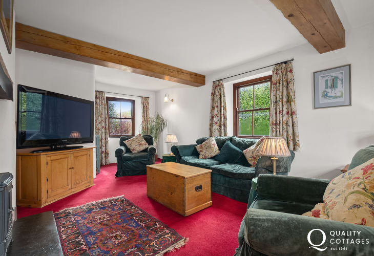 Living room in holiday home in Pembrokeshire with sofas and a pa