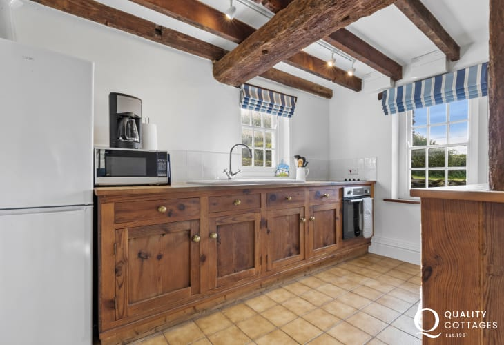 Kitchen fitted with antique pine cabinets, electric oven, electric hob, dishwasher, microwave